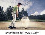 Male Golf Player In Green Shir...