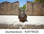Old iron cannon at the Grand Master Palace in Rhodes town, Greece. - stock photo