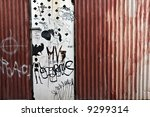 rusty fence and grafitti | Shutterstock . vector #9299314