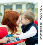 Mother and son on playground. Children send a thoughts. - stock photo