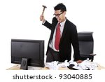 Mad businessman preparing to hitting his computer - stock photo