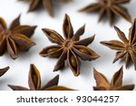 whole star anise arranged against a white background - stock photo