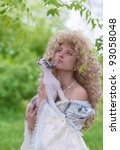 Beautiful woman in medieval dress with a cat - stock photo