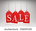 Red sale tags hanging - stock photo
