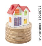 Colorful toy house on stack of euro coins - stock photo