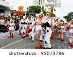 LIMASSOL,CYPRUS-MARCH 6, 2011: Unidentified women in cow and milkmaid costumes  in carnival parade. - stock photo