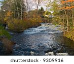 A large fast moving waterfall in the beautiful Pocono Mountains of Pennsylvania. - stock photo