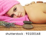 beautiful young woman in spa, stones massage - stock photo