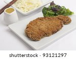 Tonkatsu - Japanese breaded deep-fried  pork cutlet served with shredded cabbage and curry sauce - stock photo