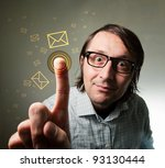 Nerd male using modern touch screen interface to check received and incoming e-mail messages in his mail inbox. - stock photo