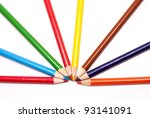 An assortment of color pencils fanned out to loo like a rainbow. - stock photo