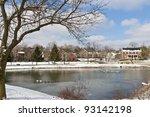 Winter city scene with a pond neighborhood recreation area. - stock photo