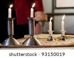 Four candles on the table - stock photo