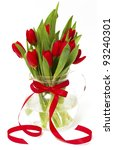Red Tulips In A Vase With A Re...