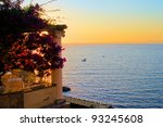 View from Sorrento, Italy at dusk from a flower draped terrace - stock photo