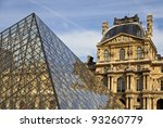 PARIS - SEPTEMBER 27: Famous glass pyramid in front of Louvre Museum (former Royal Palace) September 27, 2011 in Paris France. The Louvre Museum is the most visited monuments in France. - stock photo