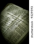 Small photo of Bible Series. close up detail of antique holy bible open to the gospel according to the epistle of paul the apostle to the galatians in the new testament finished in sepia