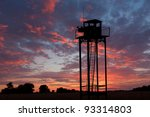 Watch Tower On Sunset Sky...