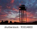 Watch Tower On Sunset Sky...