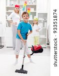 Clean up day - kids helping their mom doing chores - stock photo
