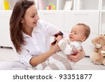 Young mother playing with her baby girl - happiness defined - stock photo