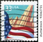 UNITED STATES OF AMERICA - CIRCA 1999: A stamp printed in the USA dedicated to the New York, shows United States Flag in front of a city, circa 1999 - stock photo