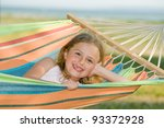 Summer holiday - lovely girl in colorful hammock - stock photo