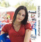 The beautiful young girl in a red dress - stock photo
