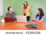 Small photo of Rude colleague disturbing meeting by talking on Smartphone
