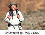 Hiking - woman hiker walking outdoors in mountain landscape smiling happy looking at copy space. Multiracial Asian Caucasian female model outdoors. - stock photo