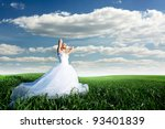 Beautiful bride in filed - stock photo
