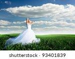 Beautiful bride in filed - stock photo