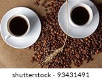 cup of coffee on a background coffee-beans and wheat spikelets - stock photo