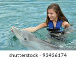 girl swimming with dolphin   Shutterstock . vector #93436174