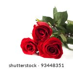 Stock photo three red roses lying on a white background the focus on the near rose 93448351