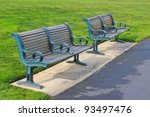 Two Benches Along A Path In A...