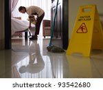 Stock photo asian maid tidying up bed and cleaning luxury hotel room 93542680