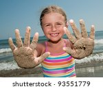 Summer vacation - girl playing on sandy beach - stock photo