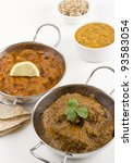 Small photo of Goan Chicken Xacuti and Meat Madras served with pilau rice, tadka dahl and chapatis