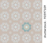 Retro snowflake style seamless wallpaper in brown and blue tones with a stand out section - stock photo