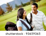 Couple of golf players at the course smiling - stock photo