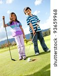 Kids at the course playing golf and looking happy - stock photo