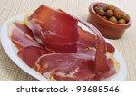 some spanish tapas, as serrano ham and olives - stock photo