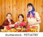 Women drinks tea with pancake during  Shrovetide - stock photo