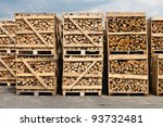 A Large Stack Of Wood For...