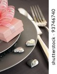 Restaurant series. Valentine' day   dinner with table setting in pink and gray  and holiday elegant  heart ornaments - stock photo