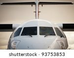 Front view of airplane in bad weather - stock photo
