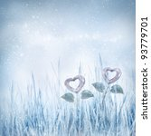 Valentines day card series. Two frozen hearts in the winter meadow. - stock photo
