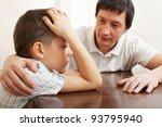 Father Comforts A Sad Child....