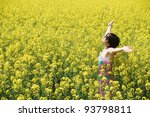 Young caucasian woman in a sea of flowers - stock photo